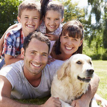 Family in the yard with their dog